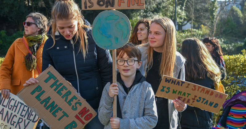 Young climate protestors holding signs that say 'There is no Planet B'